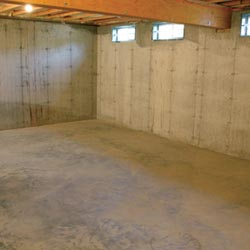 A cleaned out basement in Troy, shown before remodeling has begun